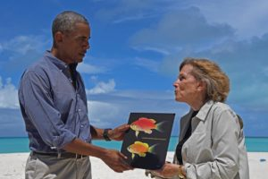 Dr. Sylvia Earle, National Geographic Explorer-in-Residence, presents President Obama with a picture of the fish that was named after him. Photograph by Brian Skerry, National Geographic